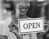 Photo Of A Woman Opening Her Business After A Consultation With A Firm In Cleveland, OH - Kasputis Law Firm LLC